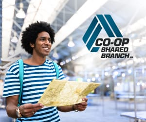 A man wearing a backpack holding a map with the CO-OP Shared Branch logo at the top right