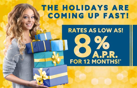 A woman holding gifts to the left of the words: The Holidays are coming up fast! Rates as low as 8% APR for 12 months!