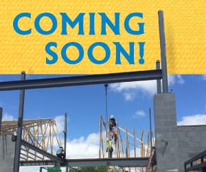 Picture of the new branch construction with a banner reading: Coming Soon!