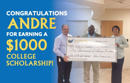 Andre Campbell holding a human-sized check for $1,000