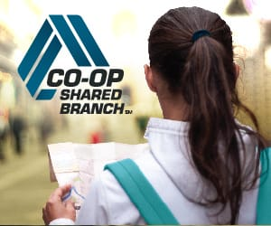 A woman wearing a backpack and holding a map to the right of the CO-OP Shared Branch logo