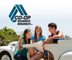 Three young people looking at a map with the CO-OP Shared Branch logo over them.