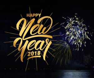 Happy New Year 2018 with fireworks in the background