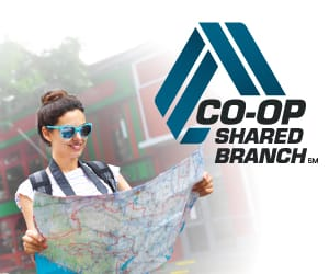 A woman wearing sunglgasses holding a global map with the Co-Op Shared Branch logo at the top right.
