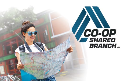 A woman wearing blue sunglasses holding a map to the left of the CO-OP Shared Branch logo.