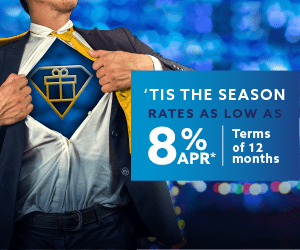 A man stretching open his sports coat and shirt revealing an icon of a present. To the right, the words: Tis the season. Rates as low as 8% APR. Terms of 12 months.