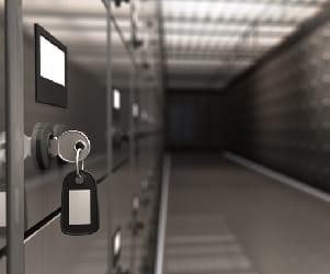 A safe deposit box with a key in it's keyhole.