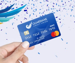 The Guardians Credit Union Debit Card with blue confetti around it.