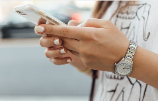 A young woman using a smart phone.