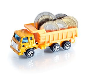 A yellow toy truck hauling coins on its bed