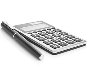 A black pen laying next to a calculator