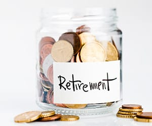 A jar of coins with a label containg the word retirement